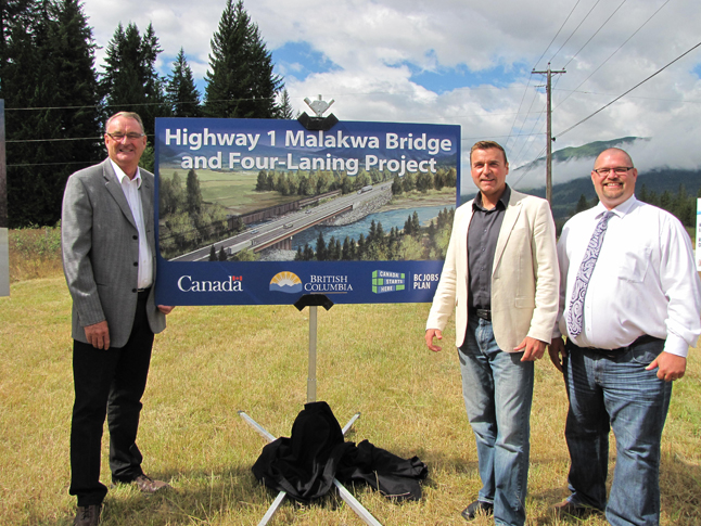 MALAKWA — MP Colin Mayes (left), MLA Greg Kyllo and Mike Klotz of Tybo Contracting pose for a photo during an event to announce a four-laning project at the Malakwa bridge along the Trans-Canada Highway. Lisanne Bowness / Ministry of Transportation and Infrastructure photo