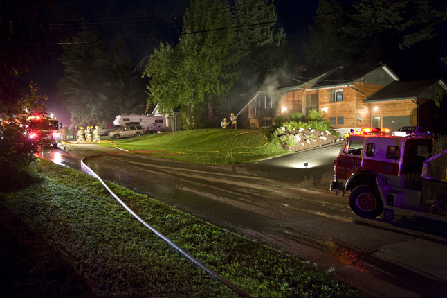 Arson is suspected as the cause of this Thursday evening, July 3, house fire on the 1500 bock of Melnyk Road in Arrow Heights that prompted a vigorous response by Fire Rescue Service personnel. Brent Veideman photo