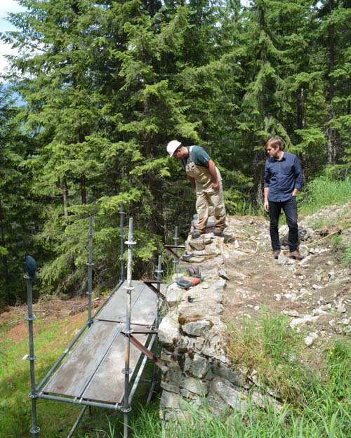 """Nick Bogovic shows Park Superintendent Nick Irving the re-pointing work being done at the """"B"""" jump wall. Jeff Bolingbroke/Parks Canada photo"""