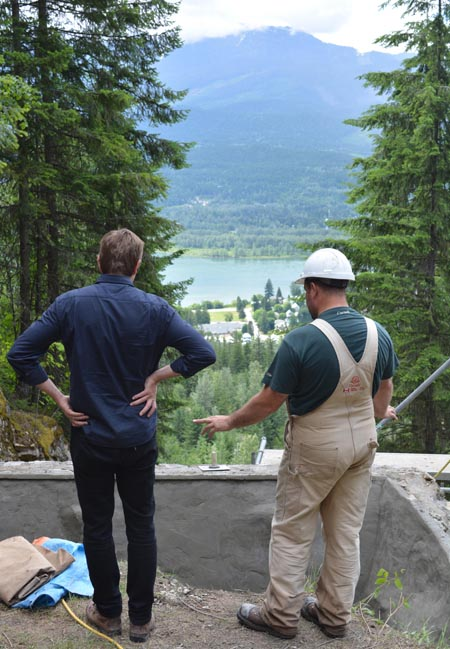Park Superintendent Nick Irving (left) checks out the progress at the 'A' jump wall. Protecting Canada's valued cultural resources is a top priority for Parks Canada.  Jeff Bolingbroke/Parks Canada photo