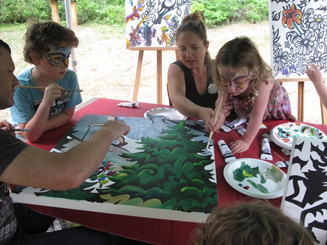 Christian and Josh Eyre paint a joint community canvas with Anita Hallewas and her daughter, Ayse Brennan. The canvases will be amalgamated into one big mural.  Laura Stovel photo