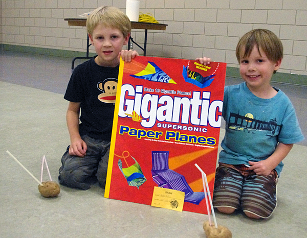 AJ and Nate Acton with the draw prize they won. Lucie Bergeron/Okanagan Regional Library photo