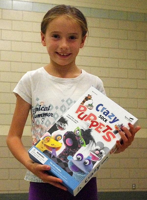 Nyssa Thomas with her prize. Lucie Bergeron/Okanagan Regional Library photo