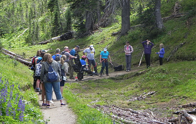 Society members pause along the trail. The intention of the TrailRider program is to provide opportunities for physically disabled and less-mobile individuals to experience the outdoors. Photo courtesy of Debra McDonald