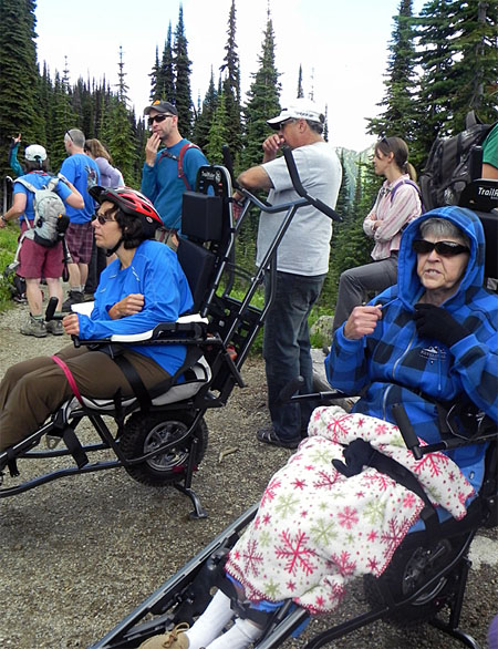 Everyone takes a breather. As you can see here, the TrailRider safely secures the rider to its frame. With a volunteer 'sherpa' in front and one in back the TrailRider allows people with disabilities to experience the joys of the wilderness. Photo courtesy of Debra McDonald