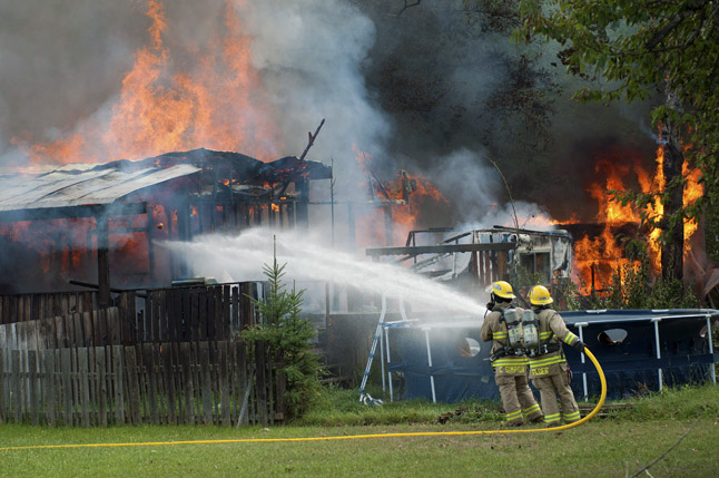 Jef Kline probably had the most dramatic photo of Fire Rescue personnel in action with this shot, taken from behind the little trailer park. It was certainly better than mine. Thanks for sharing this, Jef!  Jef Kline photo