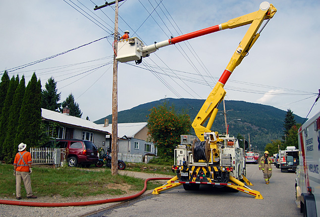 BC Hydro employees disconneted power t the burning building. David F. Rooney photo