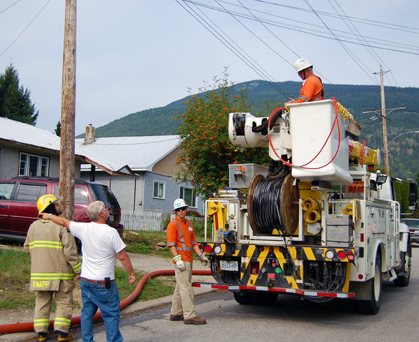 A neighbour asks about power to neighbouring residences. David F. Rooney photo