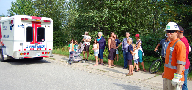 Neighbourhood residents gathered in small clumps to watch the action. David F. Rooney photo