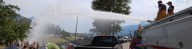 But if you didn't have any shade to keep from getting fried you pretty well had to rely on the good folks at Revelstoke Fire Rescue who came out with the tanker truck and hosed down the panting, over-heated masses. David F. Rooney photo
