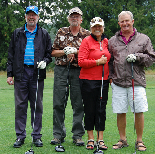 Fraser McKay, Robbie Moore, Heather Duchman and Dennis Holdener were all ready for the nine-hold tournament at the Golf Club on Friday. David F. Rooney photo