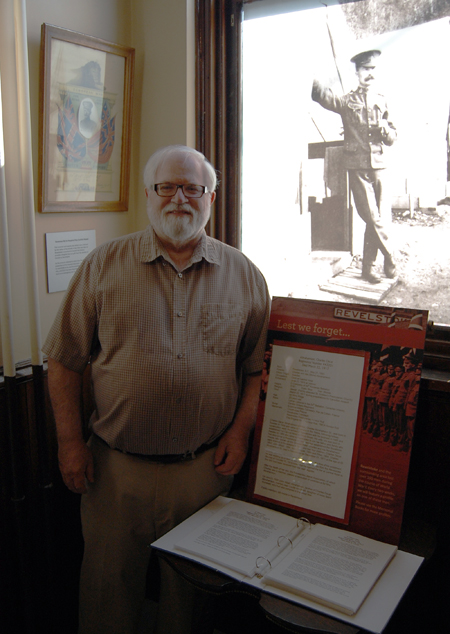 Ken English poses with the Book of Remembrance he created to breathe new life into the shades of the city's First World War dead. David F. Rooney photo