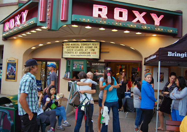 Old friends meet up in front of The Roxy. Renewing life-long friendships and acquaintances is one of the most valuable and enchanting aspects of Homecoming. David F. Rooney photo