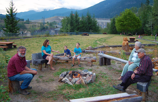 Brian Sumner (left) offered up the old-style comfort of a fireside chat at the BC Interior Forestry Museum for those who didn't want to deal with the downtown crowds. David F. Rooney photo