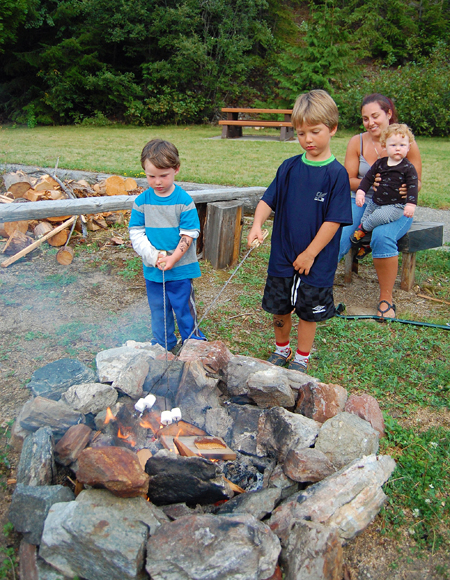 Walsh and Eldyn Pauls toast marshmallows at the fire pit under their mom's watchful eye. David F. Rooney photo