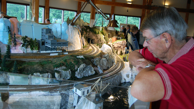 Ed Jaateenmaki seems lost in thought as he gazes on the Revelstoke Railroad Club's diorama on display on the second floor of the Railway Museum. David F. Rooney photo