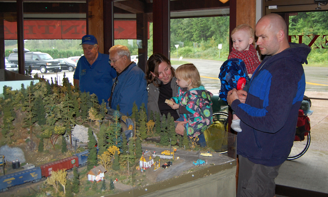 People of all ages enjoy railroad amazingly realistic and imaginative club dioramas. David F. Rooney photo