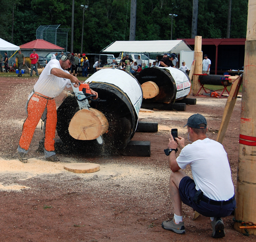 A spectator makes a quick smartphone video of one of the contestants in the chainsaw event. David F. Rooney photo