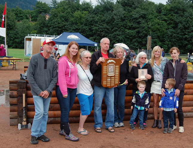 "The family of recently departed Wayne Scott was presented with the Pioneer Logger Award by Brian Sumner of the BC Interior Forestry Museum and Forest Discovery Centre. Tom, Bonnie, Jim, Kendra,  Jackson, Colleen, Cathy, Patty, and Connie. Were proud to accept it on his behalf, Born in 1951, Wayne ""did it all,"" Sumner said. He raised four kids and faced down countless challenge in his life in the bush. He almost lost a leg in one 20th century incident and suffered financial stress in the 21st century but he always persevered. ""Wayne loved being in the bush whether he was working or hunting and fishing. He was an excellent choice for this award. David F. Rooney photo"