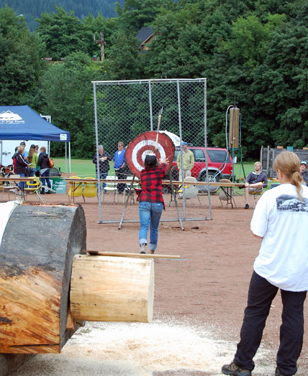 Eve Northmore tosses her axe in the Women's Axe-Throwing Contest. David F. Rooney photo