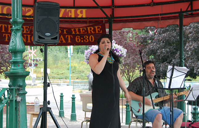 Singer/Songwriter Nina Amelio drew a crowd of about 200 people when she performed at 4 pm. Nina — better known, perhaps, to all of her RSS classmate as Christina Amelio — returned home to perform at Grizzly Plaza. Yannivy Firrne accompanied her. Nina now lives in Castlegar and is working hard to build her singing career. If you missed her performance on Saturday afternoon, yo can watch her in a soon-to-published Revelstoke Current video. David F. Rooney photo