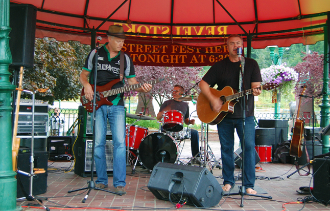 The Maritime Kitchen Party's bassist Shannon Sternloff (left), drummer Trevor Wallach and lead guitarist Steve Smith really belted out the tunes at Gripply Plaza on Saturday evening. David F. Rooney photo