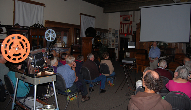 If you weren't inclined listen to music in the plaza the Bygone Era Entertainment Society provided a slate of films, including the locally made film about ski jumping back in the 1970s when Revelstoke was the country's ski-jumping capital. That's BEES director David Evans (right, back) introduces the films to be shown at the Nickelodeon Museum on Saturday evening. Nine of the 302 people who attended the event remember seeing ski-jumping on Mount Revelstoke. David F. Rooney photo