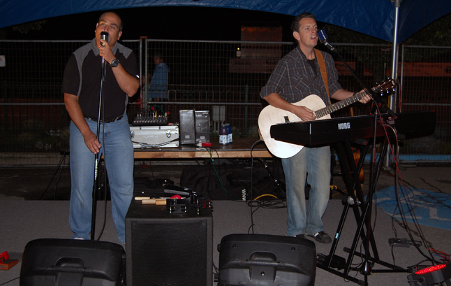 Dan Sculnick (left) and Drew Payne enjoyed singing and playing together so much they started their two-man group, the 45 Minutes Band. They put their heart and soul into their music at the Rotary Club beer garden  beside Grizzly Plaza. David F. Rooney photo