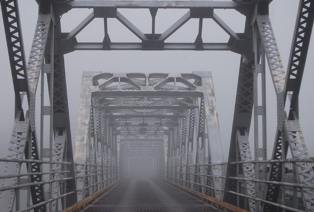 If you were out and about early Sunday morning, perhaps on your way out for a quick cycle around town or a run you might have crossed the Big Eddy Bridge, which looked like a bridge to the Twilight Zone at 8 am. David F. Rooney photo