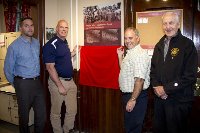 MP David Wilks (second from the left) arrived late for the ceremony — he was held up by traffic and construction on the Trans-Canada Highway during his drive here from the Columbia Valley. Here he poses with Nicholas Irving, Field Unit Superintendent, Mount Revelstoke & Glacier National Parks (left), the Mayor and Sam for a full and formal unveiling of the plaque. Sarah Mickel photo