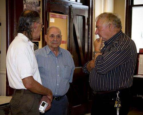 Attendees Terry Lys of Calgary and Dan Gawiuk and Walter Cwikula of Revelstoke chat during the event. Terry and his wife Lenora were on holiday in BC and came here specifically to attend one of the 100 plaque unveilings. Sarah Mickel photo