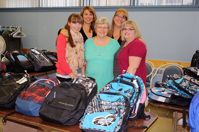 These lovely ladies from the Revelstoke Credit Union and RCU Insurance brought 38 new children's backpacks to the Community Connections Food Bank on Friday morning for distribution to needy families. 38 backpacks were donated with basic school supplies specific to each child. This program is funded entirely by the staff at Revelstoke Credit Union and RCU Insurance. Staff donate $1 every Saturday that they wear jeans. From left to right are: Allison Raven, Debbie Morabito, Patti Larson, Barb Weeden, Crystal Federico. Erin Russell photo