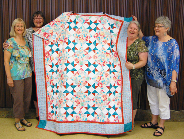 The Volunteer Medical Transportation Program is raffling off this gorgeous quilt during Homecoming. The quilt was created and donated to the program by the talented ladies of the Mount Revelstoke Quilters' Guild. All proceeds from the raffle will go to support the transportation program's fuel purchases.  Tickets go on sale on Friday, August 15, during the Seniors Citizens' Association's tea between 1 and 3 pm at the Seniors' Centre. In this image quilters Sharon Kane and Linda Walford (left) pose with the Centre's Volunteer Coordinator, Jean Pedersen, and Association President Ruth Boettger. David F. Rooney photo