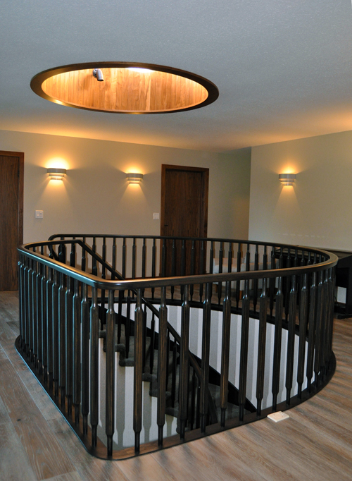 The first major feature you encounter is this magnificent stairwell leading to the bottom floor. The ceiling light well is paneled in golden chestnut. David F. Rooney photo