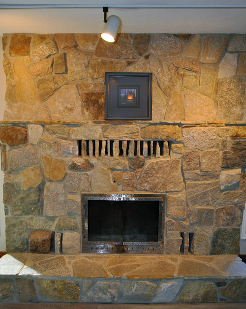 This local stone fireplace helps make the den a warm and inviting space. David F. Rooney photo