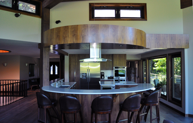 This is a view of the semi-circular kitchen. The counter and bar stools are great for informal meals. David F. Rooney photo