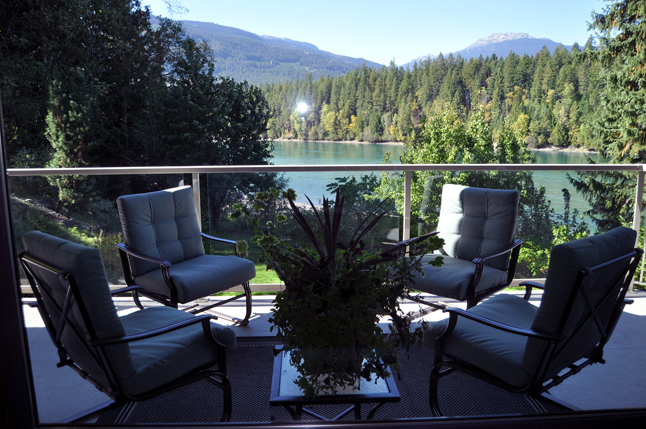 Here's a lovely view from a balcony beside the kitchen. It's a got an inviting view of the river and the mountains but the living room is the real strunner… David F. Rooney photo