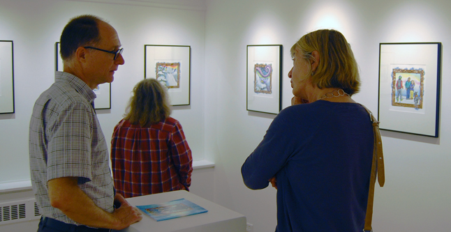 Tim Palmer and Suzanne Grieve chat in the gallery containing Zuzana Driediger's illustrations for Radar the Rescue Dog. David F. Rooney photo