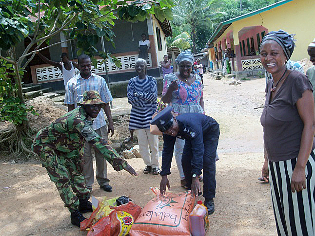 Rice and cooking oil being delivered to the compound. Photo courtesy of Manty Dabo
