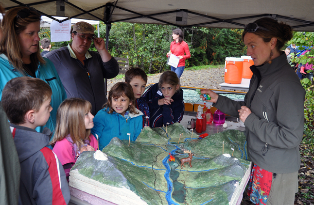 Kids and adults pay close attention to Jenny Greenwood's discussion of how water is used in the Columbia River drainage. David F. Rooney photo