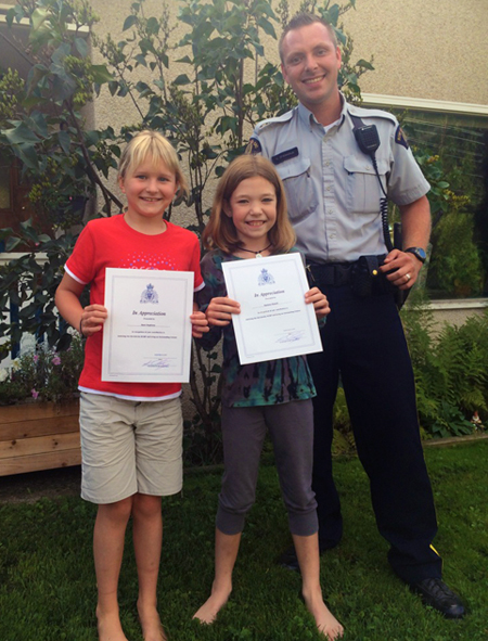 Sani Supinen and Karsyn Powell were excited to receive special certificates of appreciation from RCMP Const. Shewchuk for their honesty and good citizenship that were clearly demonstrated when they found — and retrieved — envelopes containing $400 that had been stolen from Helios Rehabilitation and Performance and then discarded on Front Street sometime between Friday night and Sunday morning. Shawn Filipchuk photo