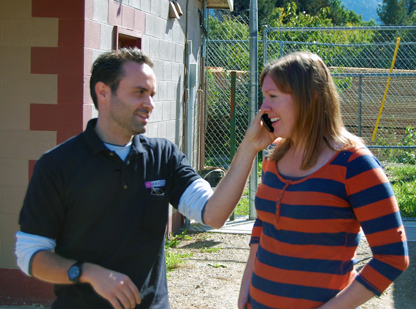 EZ Rock host Shaun Aquiline holds a cellphone to Shannon's ear so she can speak into it during a radio broadcast from the RDHS shelter on Saturday afternoon. He said events like this one that are important ways of engaging the larger community. David F. Rooney photo