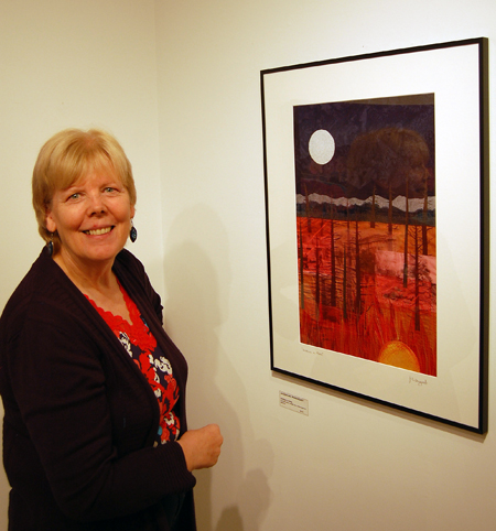 Artist Jackie Pendergast poses with her piece, Brothers in Arms. David F. Rooney photo