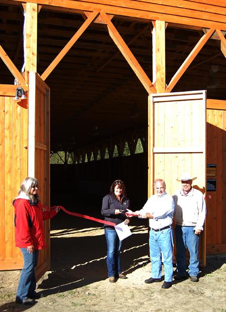 Saddle Club Secretary Tanya Secord snips the ribbon held by Mayor David Raven as Vie President Kelly Richards (left) and President Hans Michel look on. David F. Rooney photo