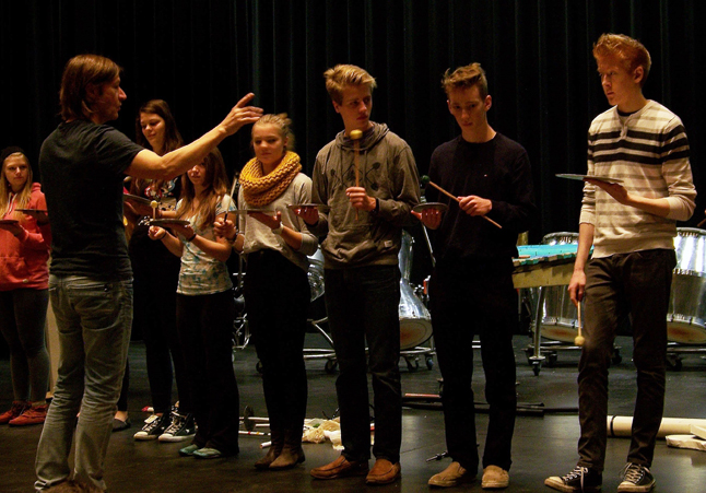 Gregory Kozak conducts students as they play the pot bottoms. Natelle Fitzgerald photo