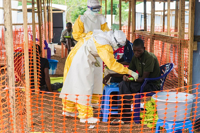 The death-dealing ebola virus has dominated the news for months and it is increasingly clear that only a global response can stop this bug in its tracks. So why does public response in western countries seem so tepid? Here in Revelstoke, at least, members of the public are being given a tangible opportunity to demonstrate their support for the beleaguered physicians and nurses (like these) of Médecins Sans Frontières on the medical front lines in Sierra Leone. Photo courtesy of Médecins Sans Frontières