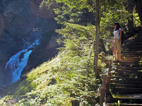 A visitor hikes hikes the stairs by Bear Creek Falls in Glacier National Park. Jeff Bolingbroke/Parks Canada photo
