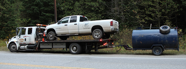 They were eventually picked up by this Columbia Towing flatbed and taken to Grizzly Automotive owner Tom Patry took a look and agreed to take time to repair the vehicle on Thanksgiving Day. Angelika Langen photo