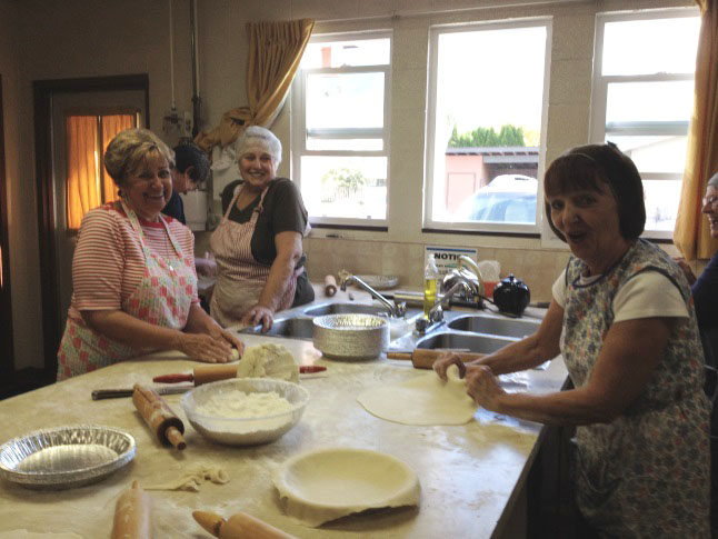 The volunteers, including these smiling ladies, were working to produce at least 1,100 pies. Laura Stovel photo