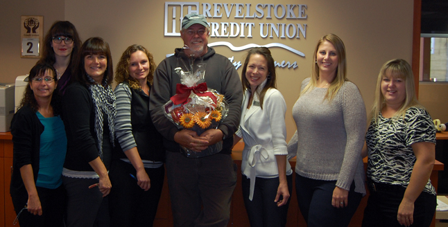 Revelstoke Credit Union member Bill Rear poses with a bevy of RCU's lovely ladies on Thursday, October 2. Bill was the very first winner of a monthly gift basket draw the financial institution started to show its appreciation for its members. Congratulations Bill! David F. Rooney photo